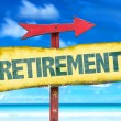 Text:Retirement on sign with beach background...