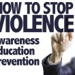 Business man pointing the text: How to Stop Violen...