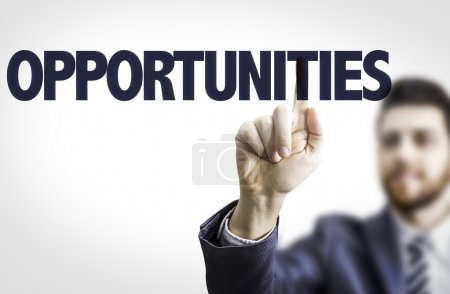 Photo for Business man pointing the text: Opportunities - Royalty Free Image