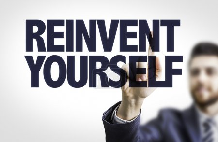Photo pour Homme d'affaires pointant vers le texte : réinventer vous-même - image libre de droit