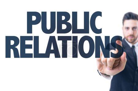 Photo pour Homme d'affaires pointant le texte : Relations publiques - image libre de droit