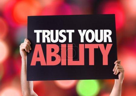 Photo pour Trust carte de vos capacités physiques avec fond bokeh - image libre de droit