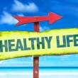 Healthy life text sign with beach background...