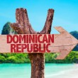 Dominican Republic wooden sign with beach backgrou...