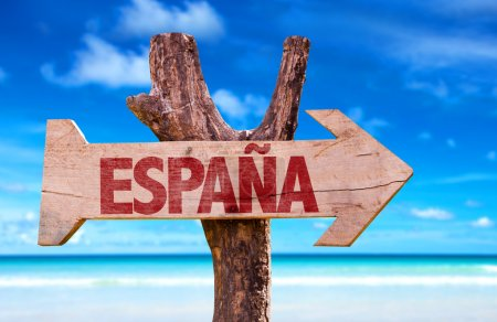 Spain (in Spanish) wooden sign with beach backgrou...