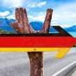 Germany Flag wooden sign with road background...