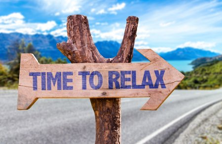 Photo for Time to Relax wooden sign with road background - Royalty Free Image