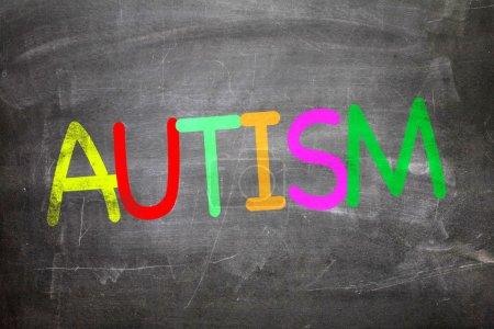 Autism written on a chalkboard