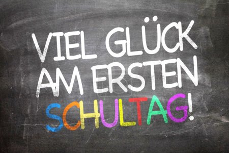 Photo for Good Luck on the First Day of School in German written on a chalkboard - Royalty Free Image