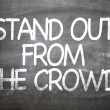 Stand Out From The Crowd written on a chalkboard...