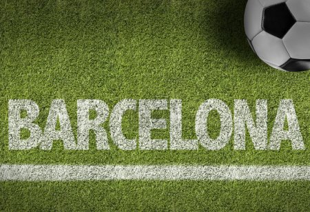 Green Soccer field with the text Barcelona...