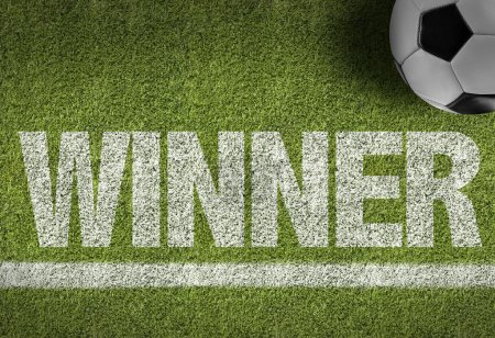 Soccer field with the text Winner