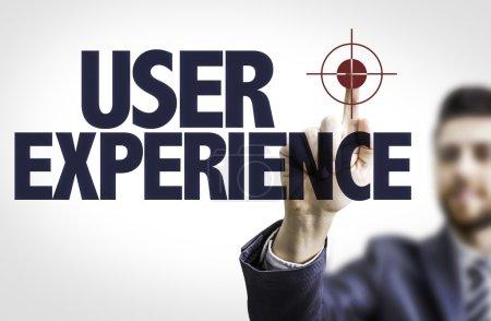 Photo pour Homme d'affaires pointant le texte User Experience - image libre de droit