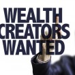 Business man pointing the text Wealth Creators Wan...