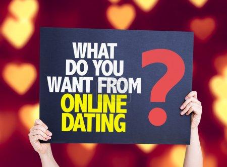 Photo pour Que voulez-vous de rencontres en ligne ? carte avec fond coeur bokeh - image libre de droit