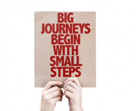 Photo for Big Journeys Begin With Small Steps cardboard isolated on white background - Royalty Free Image