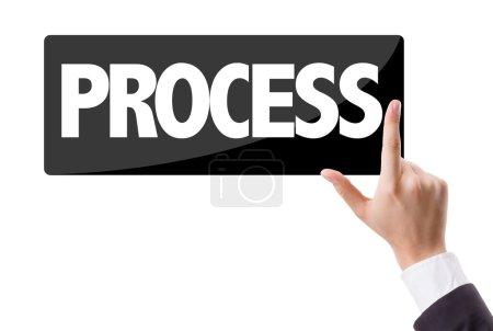 Photo pour Homme d'affaires appuyant sur le bouton avec le texte : Processus - image libre de droit