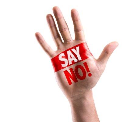 Photo pour Main ouverte levée avec le texte : Dites non ! isolé sur fond blanc - image libre de droit