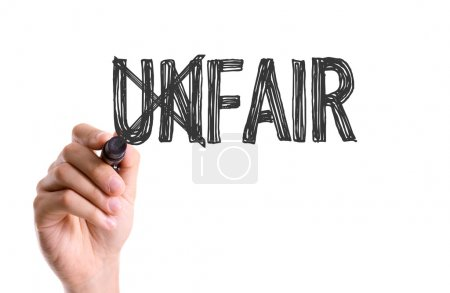 Photo for Hand with marker writing the text: Unfair/fair - Royalty Free Image