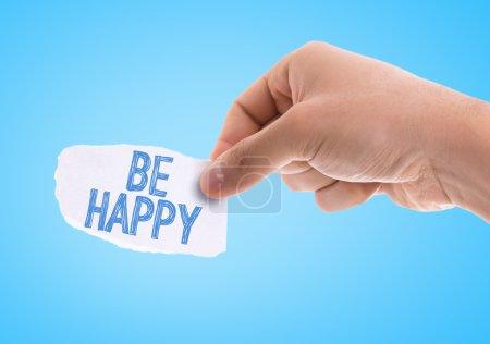 Photo pour Morceau de papier avec les mots Be Happy avec fond bleu - image libre de droit