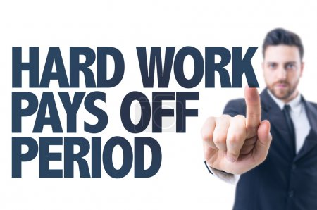 Photo for Business man pointing the text: Hard Work Pays Off Period - Royalty Free Image