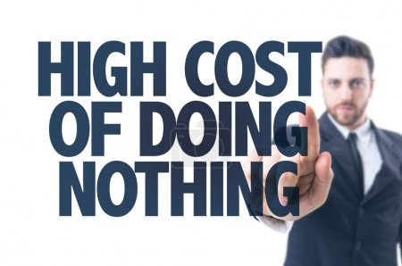 Photo for Business man pointing the text: High Cost of Doing Nothing - Royalty Free Image