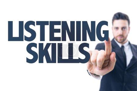 Photo pour Homme d'affaires pointant le texte : Compétences d'écoute - image libre de droit
