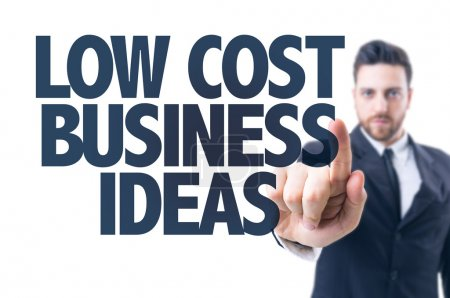 Business man pointing the text: Low Cost Business ...