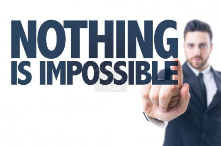 Photo for Business man pointing the text: Nothing is Impossible - Royalty Free Image