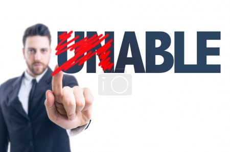 Photo for Business man pointing the text: Unable - Able - Royalty Free Image