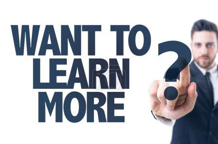 Photo pour Homme d'affaires pointant vers le texte : veulent en savoir plus? - image libre de droit