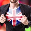 Businessman stretching suit with United Kingdom Fl...