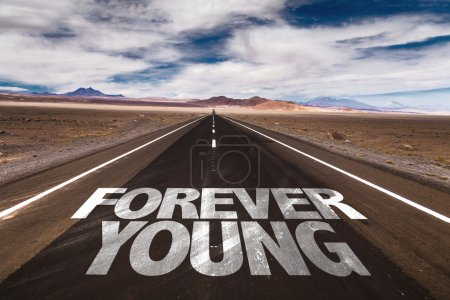 Photo for Forever Young written on desert road - Royalty Free Image