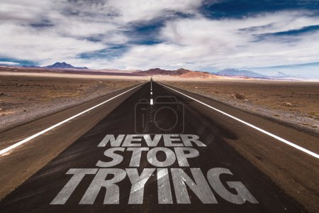 Photo for Never Stop Trying written on desert road - Royalty Free Image