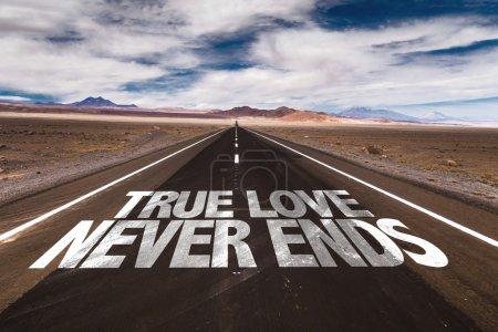 Photo for True Love Never Ends written on desert road - Royalty Free Image