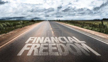Photo for Financial Freedom written on rural road - Royalty Free Image