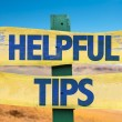 Helpful Tips sign with desert background...
