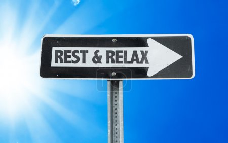 Photo for Rest & Relax direction sign with a beautiful day - Royalty Free Image