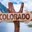 Colorado wooden sign with mountains background...
