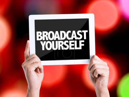 Tablet pc with text Broadcast Yourself