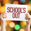Schools Out placard with bokeh background...