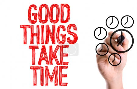 Photo for Hand with marker writing text: Good Things Take Time - Royalty Free Image