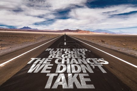 Photo for In The End We Only Regret The Chances We Didn't Take written on desert road - Royalty Free Image