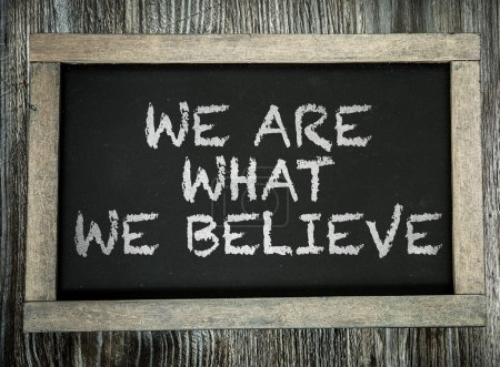 We Are What We Believe on chalkboard