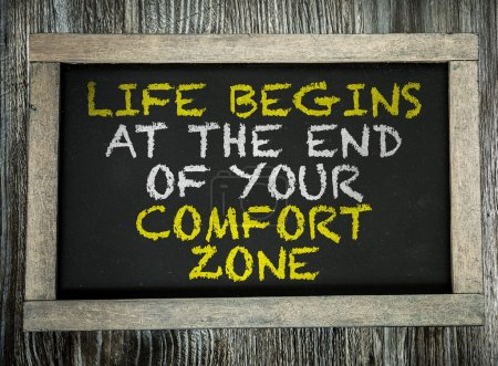 Photo for Life Begins At the End of Your Comfort Zone written on chalkboard - Royalty Free Image