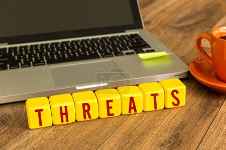 Threats written on a wooden cubes