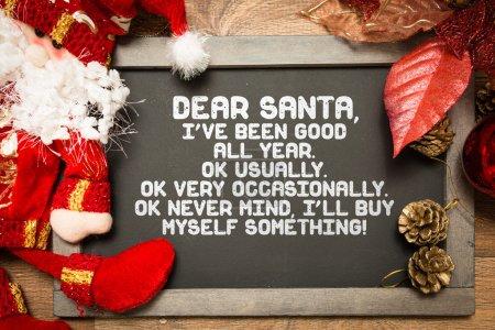 Photo pour Tableau noir avec un texte drôle de Noël dans une image conceptuelle - image libre de droit