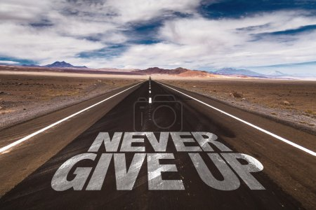 Never Give Up written on road