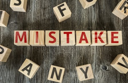 Photo for Wooden Blocks with the text: Mistake - Royalty Free Image