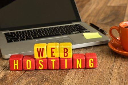 Web Hosting written on cubes